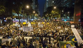 People march toward the Cinelandia square during a protest in Rio de Janeiro, Brazil, Monday, June 24, 2013. Under pressure after more than a week of nationwide protests, Brazilian leader Dilma Rousseff said Monday her government will spend $23 billion more on public transportation and announced five core areas that leaders will focus on to speed political reform and improvements to government services. (AP Photo/Felipe Dana)(AP Photo/Felipe Dana)