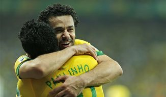 Brazil's Paulinho, left, is congratulated by his teammate Fred after scoring his side's 2nd goal during the soccer Confederations Cup semifinal match between Brazil and Uruguay at the Mineirao stadium in Belo Horizonte, Brazil, Wednesday, June 26, 2013. (AP Photo/Bruno Magalhaes)