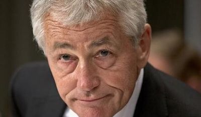 Defense Secretary Chuck Hagel prepares to testify on Capitol Hill in Washington on Tuesday, June 11, 2013, before a Senate Defense subcommittee hearing to examine department leadership. (Associated Press)