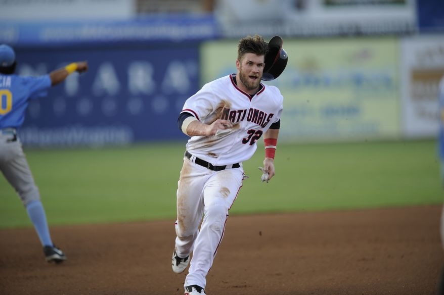 Bryce Harper loses his helmet while running from first base to third base in a rehab game with Single-A Potomac on Tuesday. (Associated Press photo)