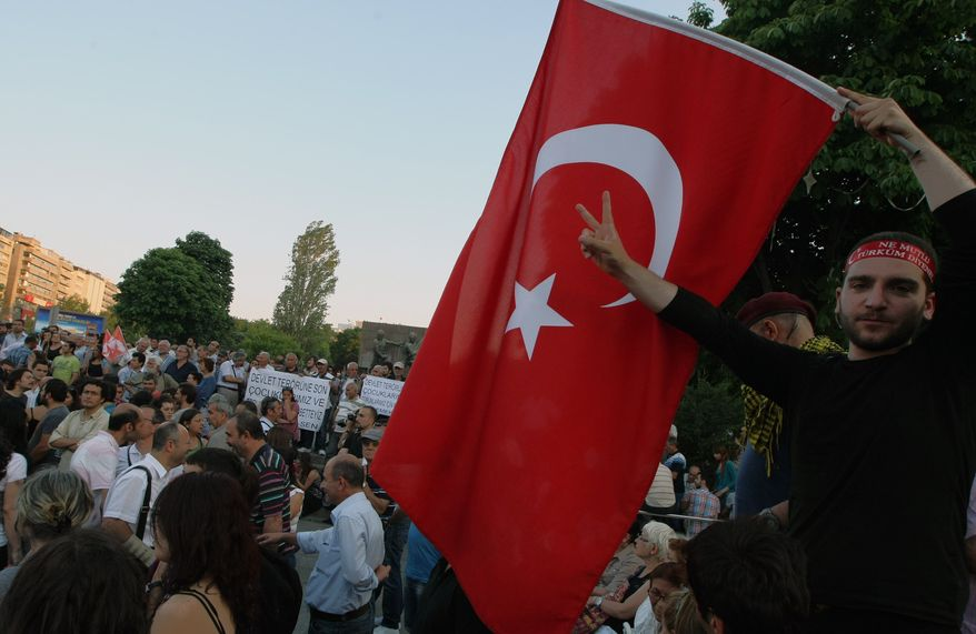 Turkish protesters gather for a protest and a forum at the main Kizilay Square in Ankara, Turkey, Tuesday, June 25, 2013. (AP Photo/Burhan Ozbilici)