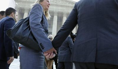 California's Proposition 8 plaintiffs Sandy Steir (center) holds hands with her partner Kris Perry (right) as they and Jeff Zarrillo, and Paul Katami (left) walk into the Supreme Court in Washington on June 26, 2013, before the court delivered opinions in two cases that could dramatically alter the rights of gay people across the United States. (Associated Press)