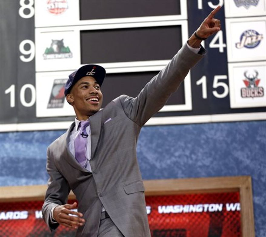 Georgetown's Otto Porter Jr., celebrates after being selected by the Washington Wizards with the third pick in the first round of the NBA basketball draft, Thursday, June 27, 2013, in New York. (AP Photo/Kathy Willens)