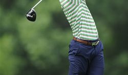 Billy Horschel tees off on the 15th tee during the first round of the AT&T National Golf tournament, Thursday, July 27, 2013, in Bethesda, Md. (AP Photo/Nick Wass)