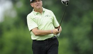 Ken Duke watches his tee shot on the 15th tee during the first round of the AT&T National Golf tournament, Thursday, July 27, 2013, in Bethesda, Md. (AP Photo/Nick Wass)