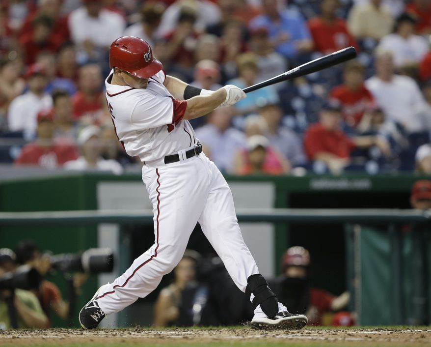 Tyler Moore homers in the Nationals' 3-2 victory over the Diamondbacks on Wednesday night. Moore's homer tied the game. (Associated Press photo)