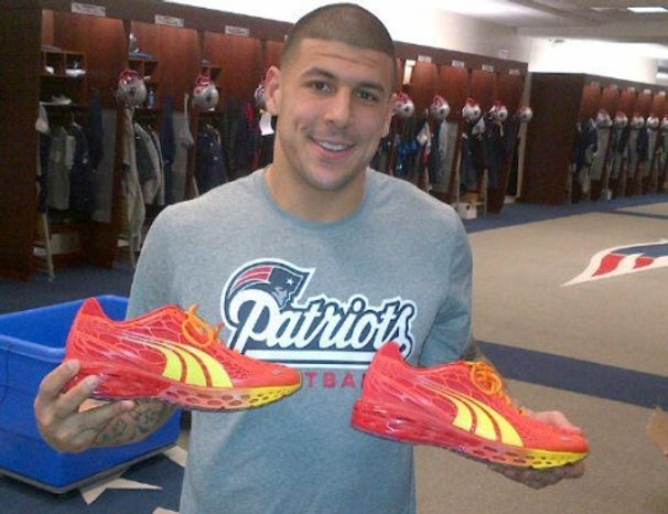 Former Patriots tight end and murder suspect shows off a pair of PUMA shoes for his Twitter followers. The company cut ties with Mr. Hernandez on Wednesday, June 27, 2013. (Twitter)