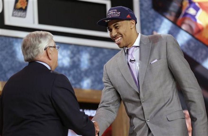 NBA Commissioner David Stern, left, shakes hands with Georgetown's Otto Porter Jr., who was selected third by the Washington Wizards in the first round of the NBA basketball draft, Thursday, June 27, 2013, in New York. (AP Photo/Kathy Willens)