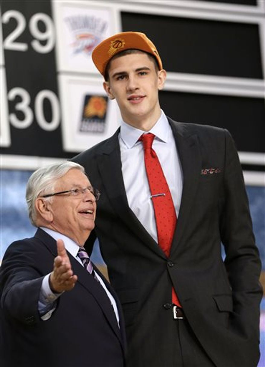 NBA Commissioner David Stern, left, poses with Alex Len, of Ukraine, who was selected by the Phoenix Suns in the first round of the NBA basketball draft, Thursday, June 27, 2013, in New York. (AP Photo/Kathy Willens)
