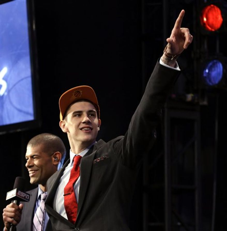 Alex Len, of Ukraine, gestures after being selected by the Phoenix Suns in the first round of the NBA basketball draft, Thursday, June 27, 2013, in New York. (AP Photo/Kathy Willens)