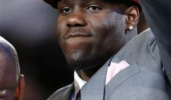 UNLV's Anthony Bennett waves after being selected first overall by the Cleveland Cavaliers in the NBA basketball draft, Thursday, June 27, 2013, in New York. (AP Photo/Jason DeCrow)