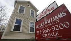 """A """"sale pending"""" sign is posted in front of a home in Cincinnati on Tuesday, March 12, 2013. (AP Photo/Al Behrman)"""