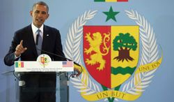 President Barack Obama gestures during a news conference with Senegalese President Macky Sall (not shown), Thursday, June 27, 2013, at the Presidential Palace in Dakar, Senegal. Obama is visiting Senegal, South Africa, and Tanzania on a week long trip. (AP Photo/Evan Vucci)