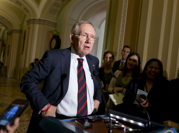 **FILE** Senate Majority Leader Harry Reid, Nevada Democrat, updates reporters on the pace of the immigration reform bill following a Democratic strategy session at the Capitol in Washington on June 25, 2013. (Associated Press)