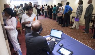 Job seekers line up to register to attend a job fair in Atlanta on Thursday, May 30, 2013. (AP Photo/John Amis)