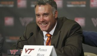 Patrick Mason smiles during his introduction as Virginia Tech baseball coach in Blacksburg, Va., Thursday, June 27 2013. Mason replaces Pete Hughes, who left after seven seasons to coach at Oklahoma. (AP Photo/The Roanoke Times, Matt Gentry)