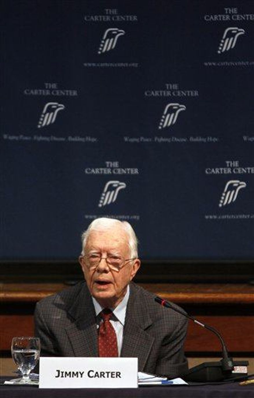 Former President Jimmy Carter presents his opening remarks during a conference on advancing women's rights, at the Carter Center on Friday, June 28, 2013, in Atlanta. (AP Photo/Jaime Henry-White)