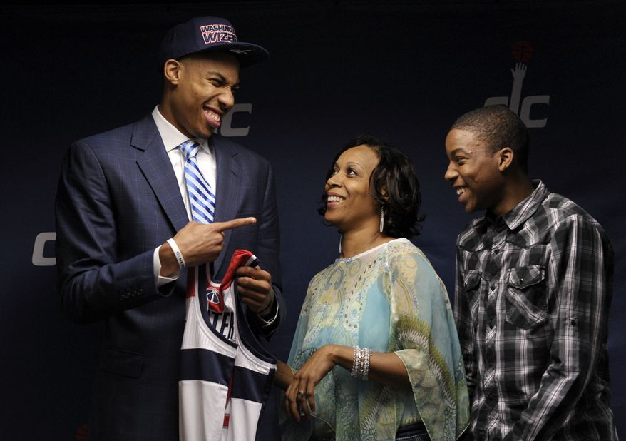 Washington Wizards 2013 top NBA basketball draft pick Otto Porter, left, smiles with his mother Elnora Porter and brother Jeffery Porter during a news conference at the Verizon Center in Washington, Friday, June 28, 2013. The Wizards selected Porter, who was the third overall pick in the NBA draft. (AP Photo/Susan Walsh)