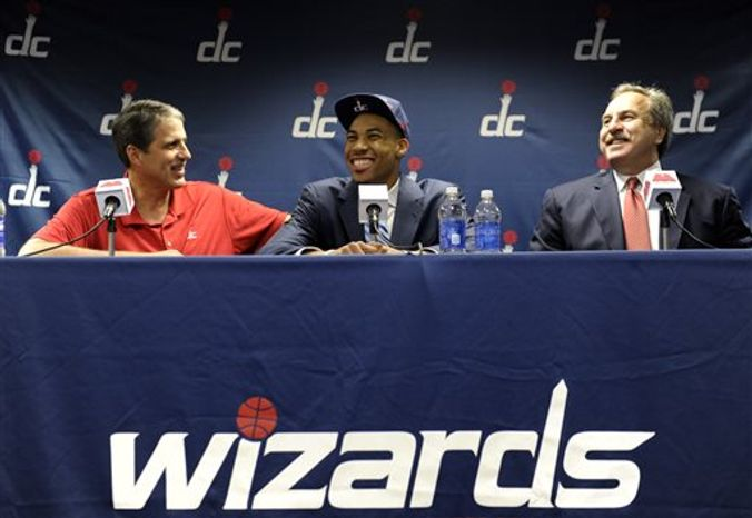 Washington Wizards 2013 top NBA draft pick Otto Porter, center, shares a laugh with Washington Wizards head coach Randy Wittman, left, and President Ernie Grunfeld, right, during a news conference at the Verizon Center in Washington, Friday, June