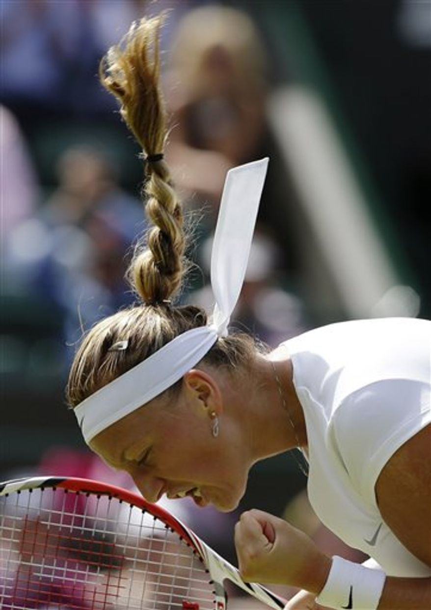 Petra Kvitova of the Czech Republic celebrates after beating Ekaterina Makarova of Russia in their Women's singles match at the All England Lawn Tennis Championships in Wimbledon, London, Saturday, June 29, 2013. (AP Photo/Anja Niedringhaus)