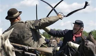 Reenactors demonstrate a cavalry battle during activities commemorating the 150th anniversary of the Battle of Gettysburg, June 29, 2013. (AP Photo/Matt Rourke) ** FILE **