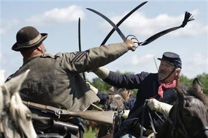 Reenactors demonstrate a cavalry battle during activities commemorating the 150th anniversary of the Battle of Gettysburg, June 29,