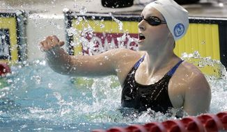 Katie Ledecky reacts after winning the women's 1,500-meter freestyle during the U.S. National Championships swimming meet in Indianapolis, Saturday, June 29, 2013. Ledecky won with a time of 15:47.15. (AP Photo/AJ Mast)