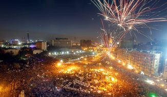 Fireworks are seen over hundreds of thousands of Egyptians gathering in Cairo's Tahrir Square during a demonstration Sunday against Egypt's Islamist President Mohammed Morsi. Supporters of Mr. Morsi also rallied, raising fears of violence.