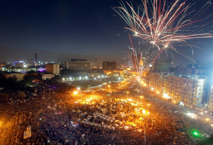 Fireworks are seen over hundreds of thousands of Egyptians gathering in Cairo's Tahrir Square during a demonstration Sunday against Egypt's Islamist President Mohammed Morsi. Supporters of Mr. Morsi also rallie