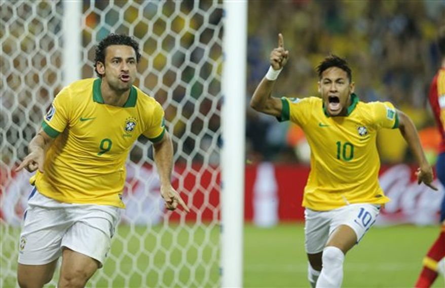 Brazil's Fred, left, and Neymar celebrate after Fred scored the opening goal during the soccer Confederations Cup final between Brazil and Spain at the Maracana stadium in Rio de Janeiro, Brazil, Sunday, June 30, 2013. (AP Photo/Victor R. Caivano)
