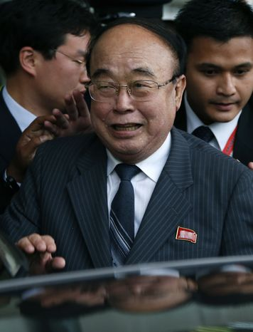 North Korean Foreign Minister Pak Ui-chun is escorted by security personnel upon his arrival at the airport in Bandar Seri Begawan, Brunei, on Sunday, June 30, 2013, for the 46th ASEAN foreign ministers meeting. (AP Photo/Vincent Thian)