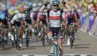 Jan Bakelants of Belgium crosses the finish line to win the second stage of the Tour de France cycling race over 156 kilometers (97.5 miles) with start in Bastia and finish in Ajaccio, Corsica island, France, Sunday June 30, 2013. (AP Photo/Laurent Rebours)