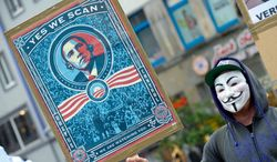 A demonstrator in Hanover, Germany, protests Internet and telephone surveillance by the U.S. National Security Agency on Saturday, June 29, 2013. (AP Photo/dpa, Peter Steffen)