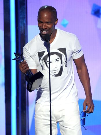 ** FILE ** Jamie Foxx accepts the award for best actor at the BET Awards on June 30, 2013, at the Nokia Theatre in Los Angeles. (Frank Micelotta/Invision/Associated