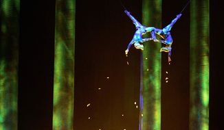 """In this Nov. 28, 2008, photo, Sarah Guyard-Guillot, left, and Sami Tiaumassi perform as """"Forest People"""" during Cirque du Soleil's """"Ka"""" at MGM Grand Resort in Las Vegas. Guyard-Guillot, a mother of two young children, was pronounced dead at a hospital late Saturday night, June 29, 2013, after falling about 50 feet from the show's stage during a performance of Cirque du Soleil's """"Ka."""" (AP Photo/Las Vegas Sun, Leila Navidi)"""