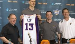 **FILE** Phoenix Suns President of Basketball Operations Lon Babby, left, introduces draft pick Alex Len, as they are joined by general manager Ryan McDonough and coach Jeff Hornacek, right, on Friday, June 28, 2013, in Phoenix. (AP Photo/The Arizona Republic, Rob Schumacher)