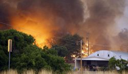 Homes burn as the Yarnell Hill Fire approaches Glenn Ilah on Sunday, June 30, 2013, near Yarnell, Ariz. The fire started Friday and picked up momentum as the area experienced high temperatures, low humidity and windy conditions. It has forced the evacuation of residents in the Peeples Valley area and in the town of Yarnell. (AP Photo/The Arizona Republic, David Kadlubowski)