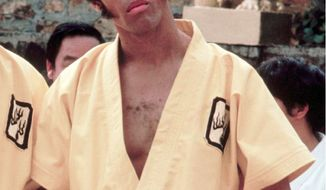 "This 1973 photo released by Warner Bros. Entertainment shows Jim Kelly as Williams in a scene from ""Enter the Dragon."" Kelly, who played a glib American martial artist in ""Enter the Dragon"" with Bruce Lee, died June 29, 2013 of cancer at his home in San Diego. He was 67. (Associated Press/Warner Bros. Entertainment)"
