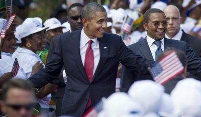 U.S. President Barack Obama shakes the hands of a line of women stationed to welcome his arrival, accompanied by Tanzanian President Jakaya Kikwete, right, at State House in Dar es Salaam, Tanzania Monday, July 1, 2013. (AP Photo/Ben Curtis)