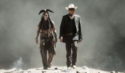 """Johnny Depp, left, as Tonto, and Armie Hammer, as the Lone Ranger, in a scene from the film, """"The Lone Ranger.""""  (AP Photo/Disney/Jerry Bruckheimer, Inc., Peter Mountain, File)"""