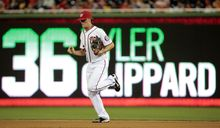 Washington Nationals relief pitcher Tyler Clippard (36) runs to the mound during a baseball game against the Milwaukee Brewers at Nationals Park Monday, July 1, 2013, in Washington. The Nationals won 10-5. (AP Photo/Alex Brandon)