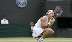 Sabine Lisicki of Germany celebrates after winning her Women's singles quarterfinal match against Kaia Kanepi of Estonia at the All England Lawn Tennis Championships in Wimbledon, London, Tuesday, July 2, 2013. (AP Photo/Alastair Grant)