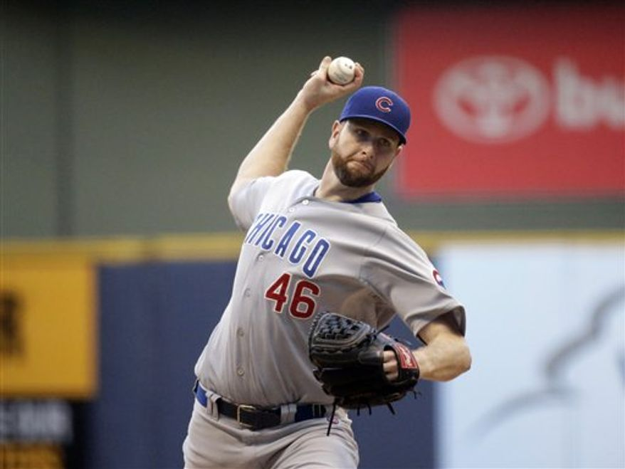 **FILE** Chicago Cubs starting pitcher Scott Feldman throws during the first inning of a baseball game against the Milwaukee Brewers Wednesday, June 26, 2013, in Milwaukee. (AP Photo/Morry Gash)