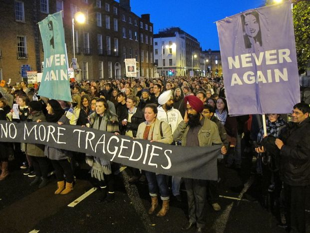 Several thousand abortion-rights protesters march through central Dublin on Saturday, Nov. 17, 2012, to demand that Ireland's government allow abortions to save a woman's life. (AP Photo/Shawn Pogatchnik)
