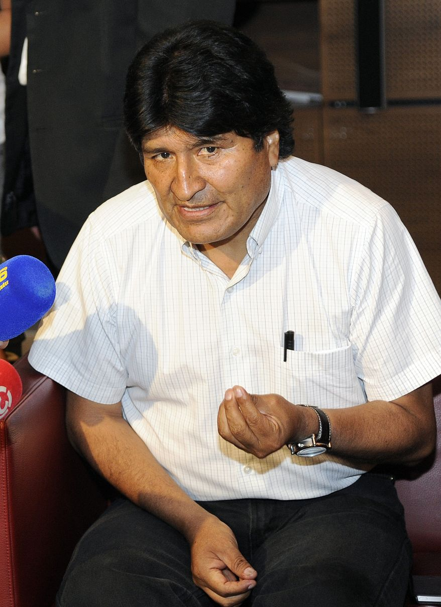 Bolivian President Evo Morales talks to reporters at Schwechat Airport outside Vienna, Austria, on Wednesday, July 3, 2013. Mr. Morales plane was rerouted to Austria after various European countries refused to let it cross their airspace because of suspicions that NSA leaker Edward Snowden was on board, Bolivian officials said Tuesday. (AP Photo/Hans Punz)