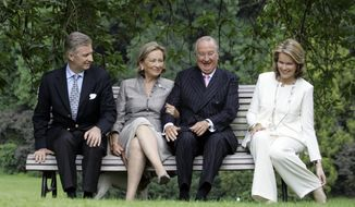 Belgium's Crown Prince Philippe (from left), Queen Paola, King Albert II and Princess Mathilde sit during an official photo session at the Royal Palace in Laeken, Belgium, in 2008. (AP Photo/Virginia Mayo)