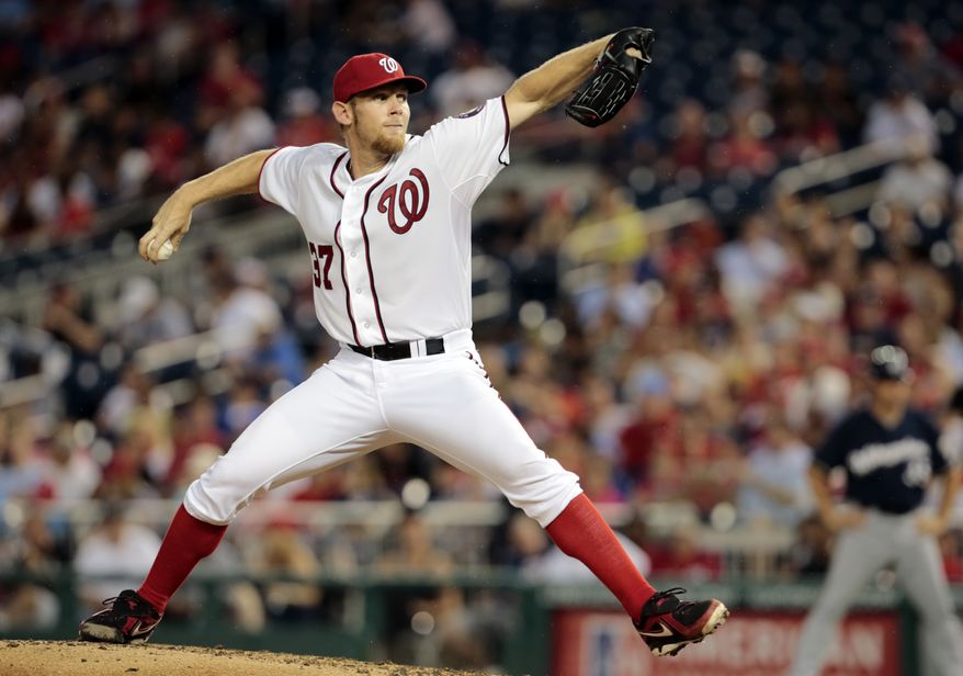 Stephen Strasburg tossed seven scoreless innings over the Brewers on Tuesday night, but it was for naught as the Nationals lost 4-0. (Associated Press photo)