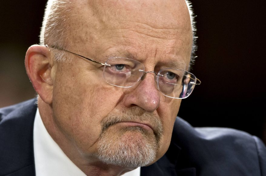 ** FILE ** National Intelligence Director James Clapper testifying on Capitol Hill in Washington, April 18, 2013. Clapper is apologizing for telling Congress earlier this year that the National Security Agency does not collect data on millions of Americans. (AP Photo/J. Scott Applewhite, File)