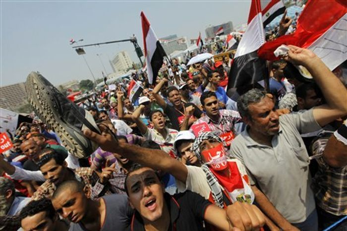 Opponents of Egypt's Islamist President Mohammed Morsi shout slogans during a protest in Tahrir Square in Cairo, Egypt, Wednesday, July 3, 2013. (AP Photo/Amr Nabil)