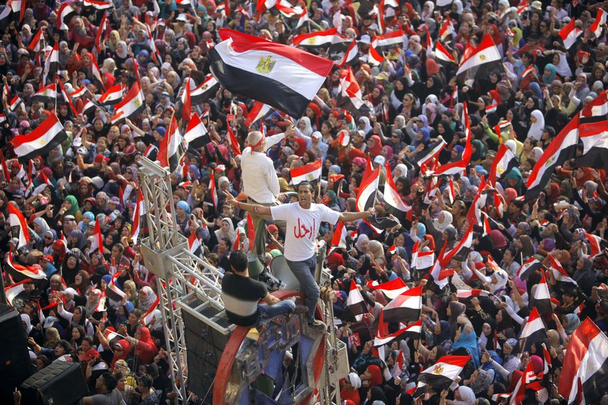 Opponents of Egypt's Islamist President Mohammed Morsi shout slogans and wave a national flags in Tahrir Square in Cairo, Egypt, Wednesday, July 3, 2013. The deadline on the military's ultimatum to President Mohammed Morsi has expired, with 48 hours passing since the time it was issued. (AP Photo/Amr Nabil)